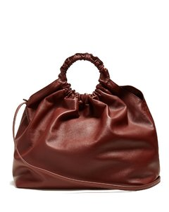 Circle-handle leather bag